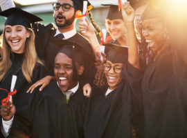 Shot of a group of cheerful university students on graduation day