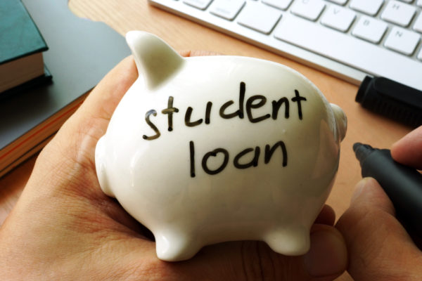 Student loan written on a piggy bank.