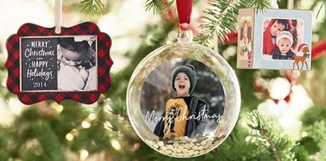 personalized ornaments for the christmas tree with pictures of loved ones on them.