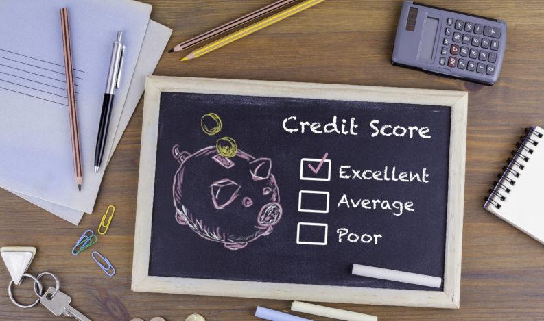 Excellent Credit Score concept. Chalkboard on wooden office desk