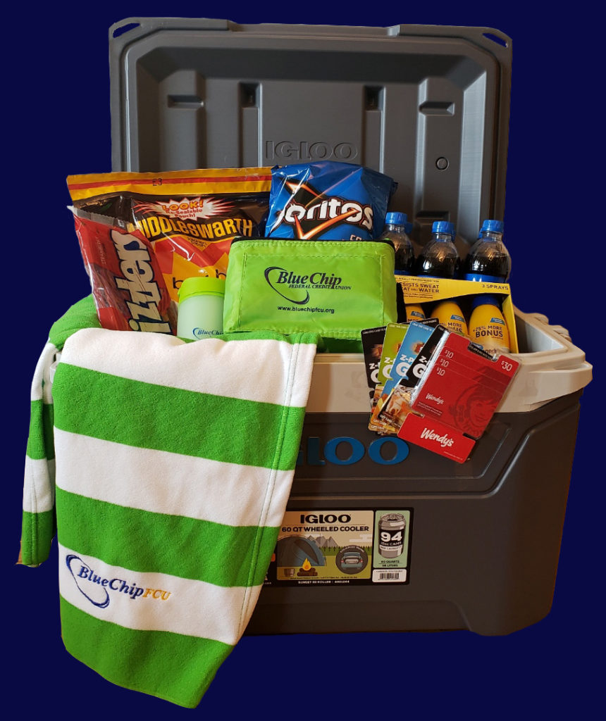prize package including a cooler, snacks, beach towels and other items you would want on a road trip.