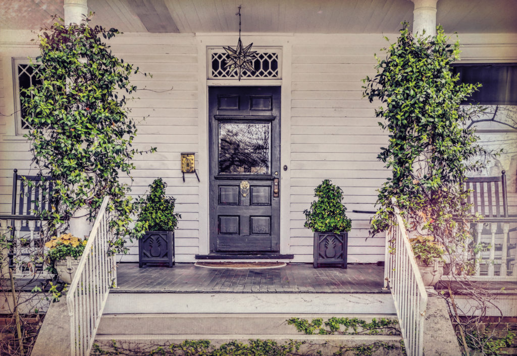 Southern front door painted navy blue