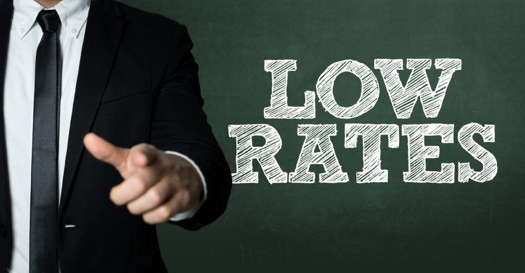 Business man pointing with the text: Low Rates from credit unions