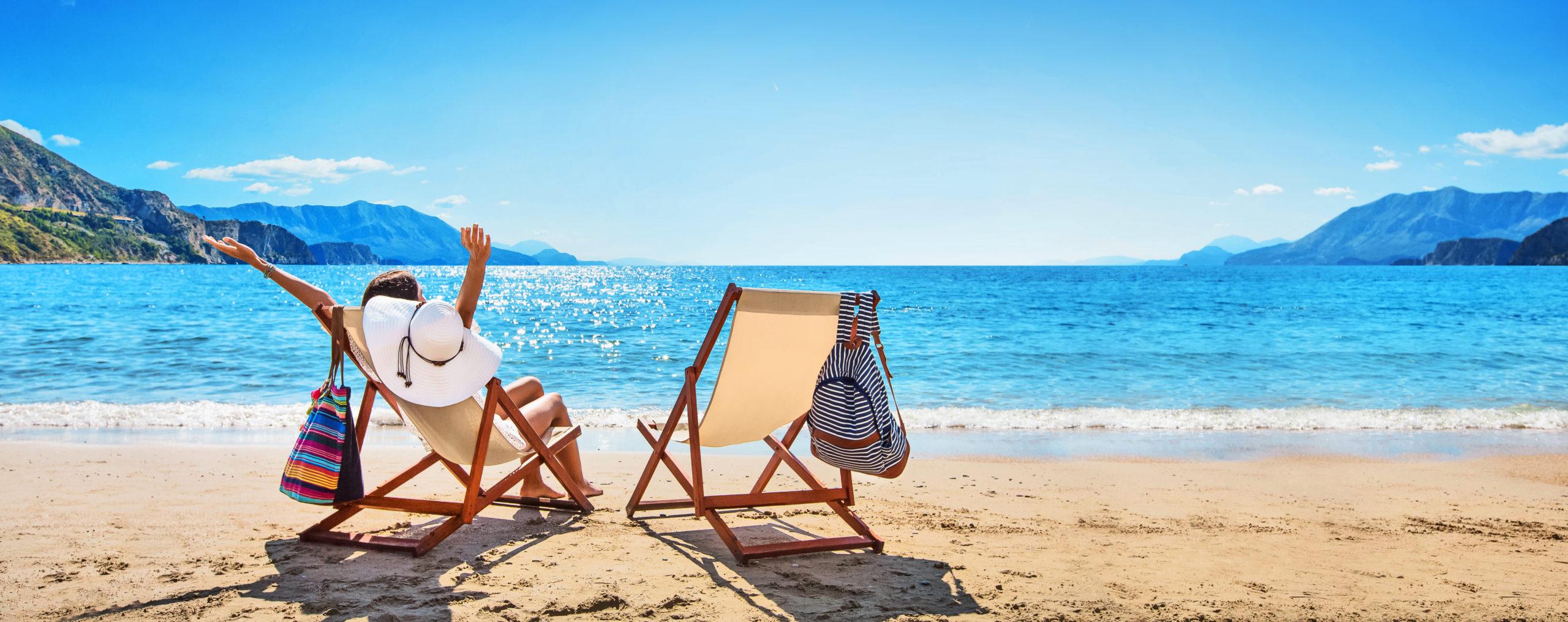 Woman Enjoying Sunbathing at Beach. Summer Vacation