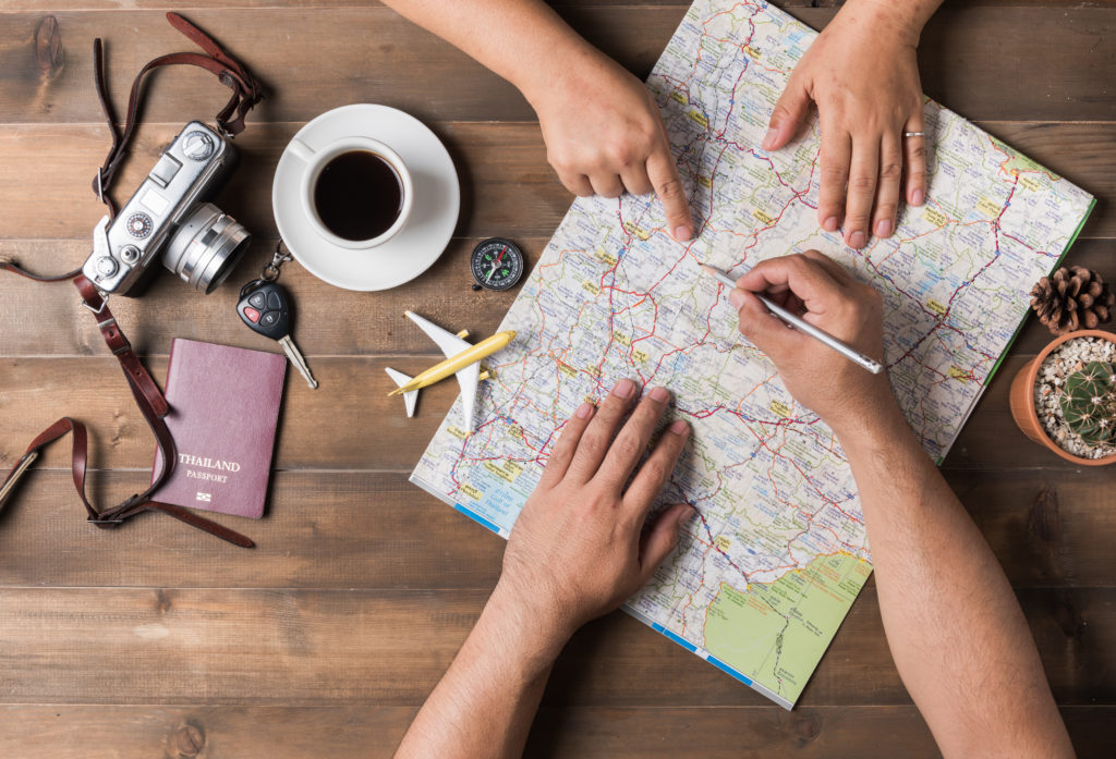 Young couple planning  vacation trip with map. Top view. Pointing to Thailand map