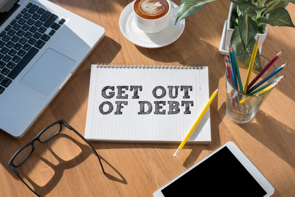 Get Out of Debt concept open book on table and coffee Business